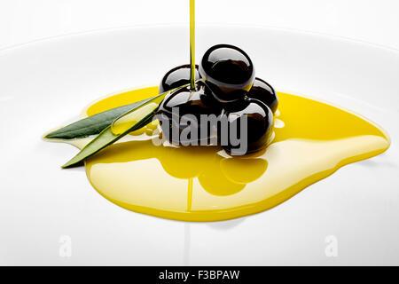 Black olives extra virgin olive oil - Stock Photo