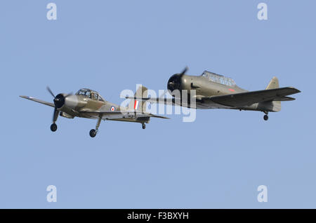 World War 2 North American T-6 Texan (Harvard) and 1950s Percival P-56 Provost T1 in formation at the Airshow Season - Stock Photo
