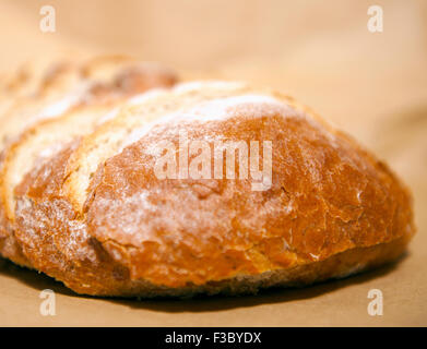 Close-up view of sliced rustic bread loaf - Stock Photo