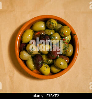 Overhead view of a small bowl of mixed olives - Stock Photo