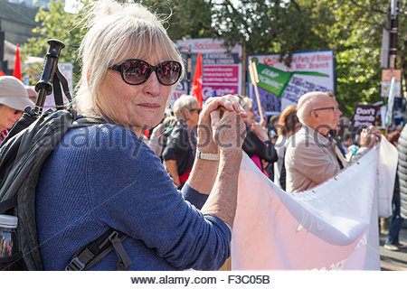 Manchester, UK. 4th October, 2015. Anti austerity rally in Manchester, UK. Meg McDonald, 73, from London, member - Stock Photo