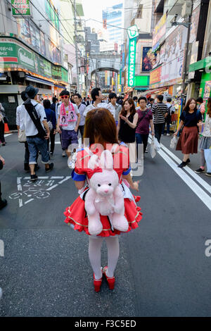 Young woman advertising Maids' Cafe in Akihabara known as Electric Town or Geek Town selling Manga based games in - Stock Photo