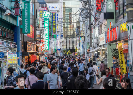 Busy street in Akihabara known as Electric Town or Geek Town selling Manga based games and videos in Tokyo Japan - Stock Photo