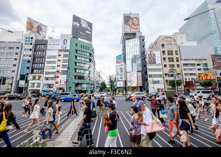 Busy pedestrian crossing at fashionable Omotesando district in Tokyo Japan - Stock Photo