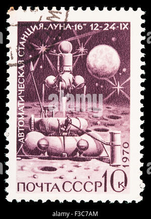 SOVIET UNION - CIRCA 1970: A postage stamp printed in Soviet Union shows a Lunar probe landing on the moon surface, - Stock Photo