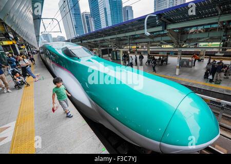 Hayabusa E5 Shinkansen bullet train of East Japan Railways at Tokyo Station Japan - Stock Photo