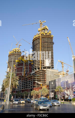 Three high-rise apartment towers under construction in Downtown Dubai district in United Arab Emirates - Stock Photo
