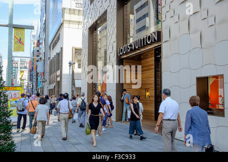 Busy street in upmarket shopping district of Ginza in Tokyo Japan - Stock Photo