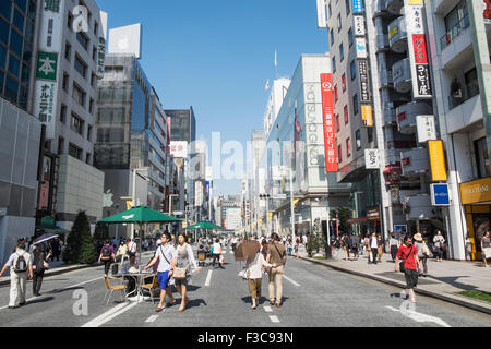 Busy pedestrian street in upmarket shopping district of Ginza in Tokyo Japan - Stock Photo