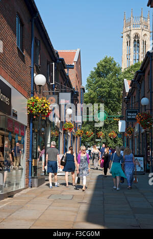 People visitors tourists walking along Coppergate shopping centre in summer York North Yorkshire England UK United - Stock Photo