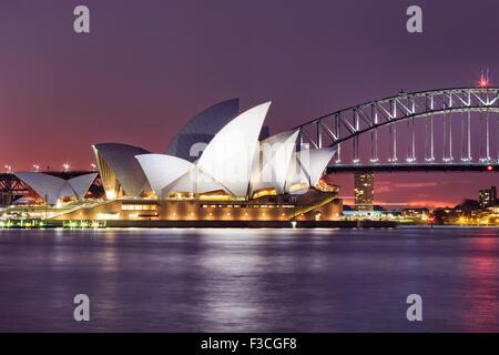 SYDNEY, AUSTRALIA, 10 JULY 2015 - Sydney opera house and Harbour bridge in Sydney at sunset. Iconic and world famous - Stock Photo