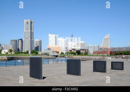 Skyline of modern Minato Mirai district of Yokohama in Japan - Stock Photo