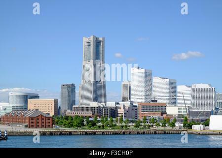 Landmark Tower and skyline of modern Minato Mirai district of Yokohama in Japan - Stock Photo