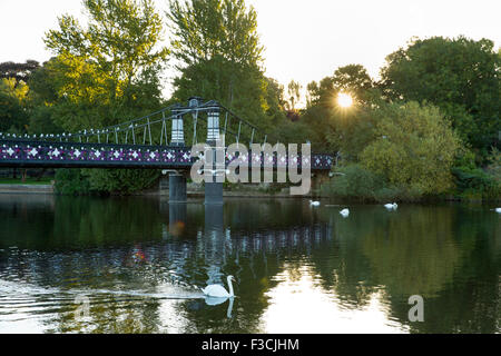 The ornate boardwalk bridge that spans the River Trent between the Dingle and St Peter's Bridge taken at Dawn in - Stock Photo