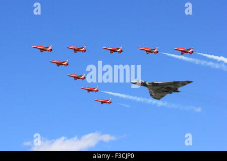 Last flight of Vulcan Bomber and Red Arrows at Royal International Air Tattoo 2015 (RIAT) in formation - Stock Photo