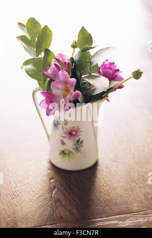 Fresh cut flowers in vase - Stock Photo