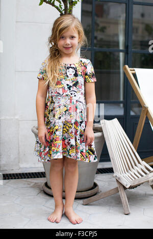 Little girl standing outdoors, portrait - Stock Photo