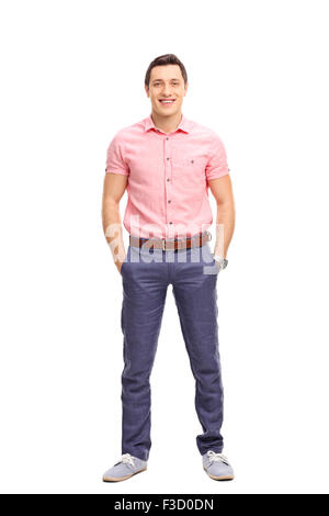 Full length portrait of a cheerful young man in casual outfit standing and looking at the camera isolated on white - Stock Photo