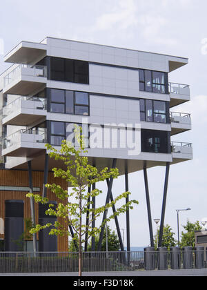 Living on stilts, modern Norwegian architecture in Fornebu near Oslo Norway - Stock Photo