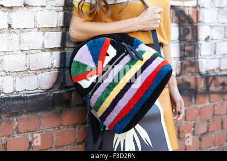 Negin Mirsalehi poses for photographers with Fendi backpack before Fendi show during Milan Fashion Week - Stock Photo