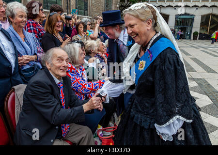 A Couple In Victorian Costume Entertain The Crowd At The Annual Pearly Kings and Queens Harvest Festival, Guildhall, - Stock Photo