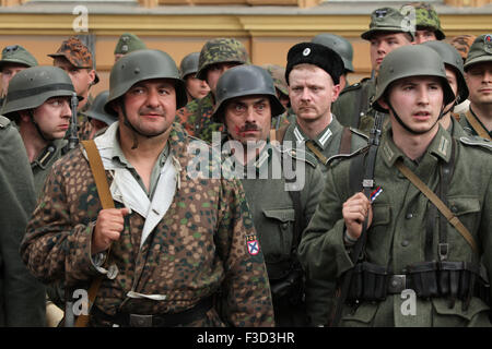 Reenactors uniformed as soldiers of the Russian Liberation Army (ROA) attend the reenactment of the 1945 Prague - Stock Photo