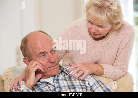 Woman Comforting Senior Man With Depression - Stock Photo