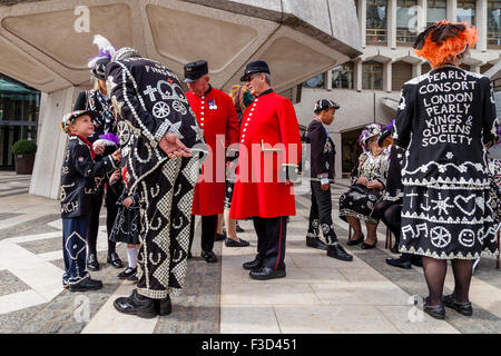 A Pearly King Shakes Hands With A Pearly Prince At The Pearly Kings and Queens Harvest Festival, The Guildhall, - Stock Photo
