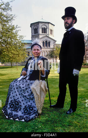 Queen Victoria and Prince Albert costumed characters posing outside the Mausoleum. Frogmore. Windsor. Berkshire. - Stock Photo