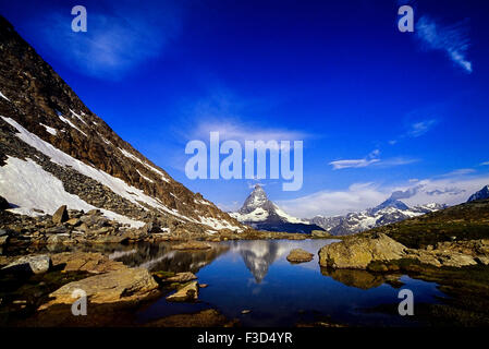 The Matterhorn reflected in a mountain lake above Zermatt. Switzerland. Europe - Stock Photo
