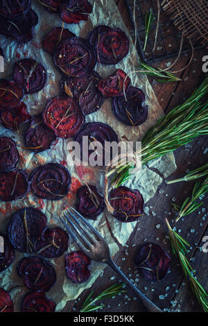Beetroot crisps with rosemary - Stock Photo