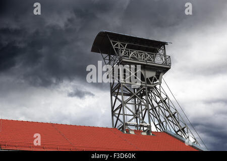 Dark clouds over shaft mining - mining the concept of bankruptcy. - Stock Photo