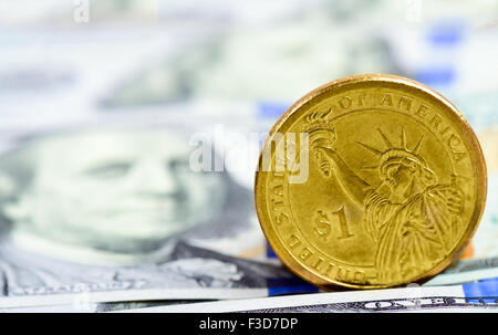 a coin in the dollar on the American banknotes - Stock Photo