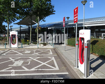 Electric Car Charging Point at South Mimms Motorway Services on the M25 for Tesla Cars - Stock Photo