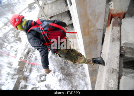 ZHELEZNODOROZHNIY, RUSSIA - March 9, 2008 - Rope jumping event held at the abandoned building construction site. - Stock Photo