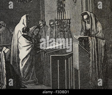Religion. Judaism. Rabbi is reading in Torah at Synagogue. Engraving by Froment, published on La Ilustracion, 1870, - Stock Photo