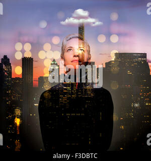 Young woman looking up at night - Stock Photo
