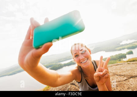 Young woman taking selfie on Smartphone