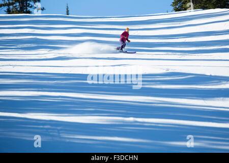 Woman skiing downhill - Stock Photo