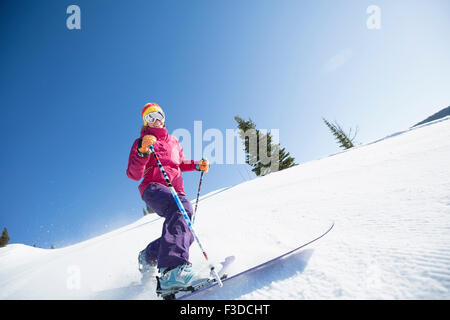 Woman skiing downhill - Stock Photo