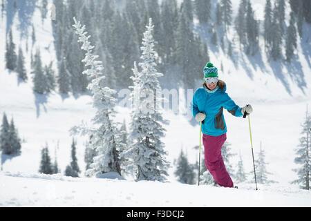 Female skier on hill - Stock Photo