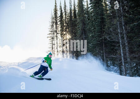 Man skiing downhill - Stock Photo