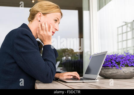 Woman working at desk - Stock Photo