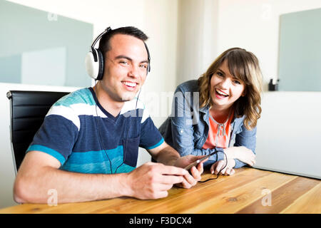 Office workers smiling - Stock Photo