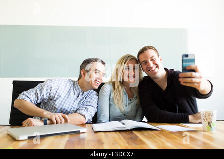 Office workers taking selfie - Stock Photo