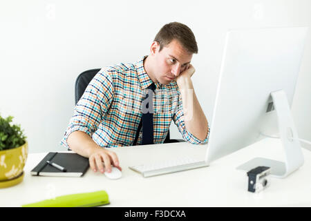 Young man working in office - Stock Photo