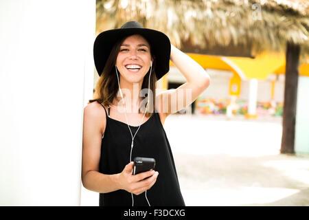 Portrait of woman wearing hat - Stock Photo