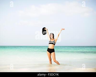 Happy woman on beach - Stock Photo