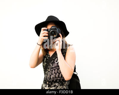 Woman taking photos during vacations - Stock Photo