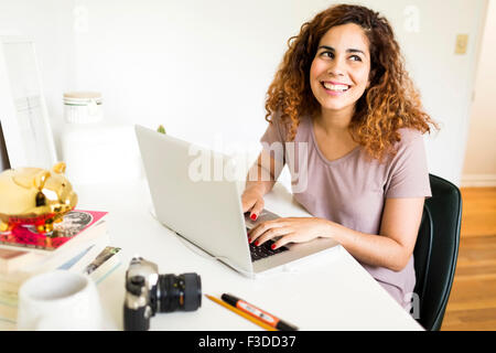 Woman using laptop - Stock Photo